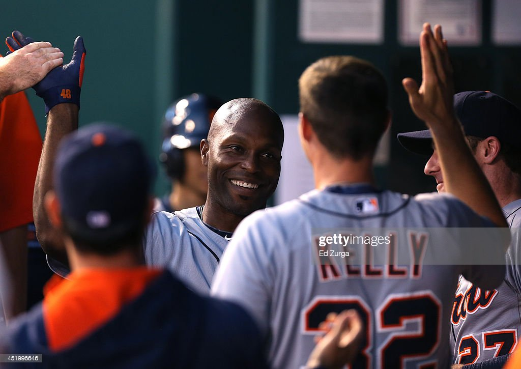 Torii Hunter #48 of the Detroit Tigers celebrates his home run with Don Kelly #32 in the fifth inning during a game against the Kansas City Royals at Kauffman Stadium on July 10, 2014 at Kauffman Stadium in Kansas City, Missouri.