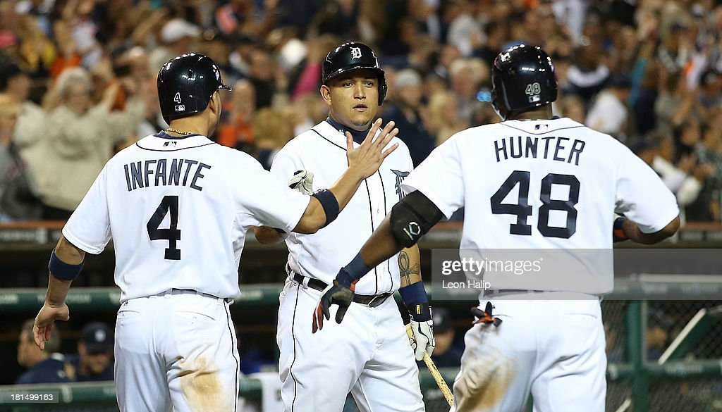Torii Hunter #48 of the Detroit Tigers celebrates with teammate Miguel Cabrera #24 after hitting a sacrifice fly to score Omar Infante #4 to tie the game in the ninth inning of the game against the Chicago White Sox at Comerica Park on September 21, 2013 in Detroit, Michigan.