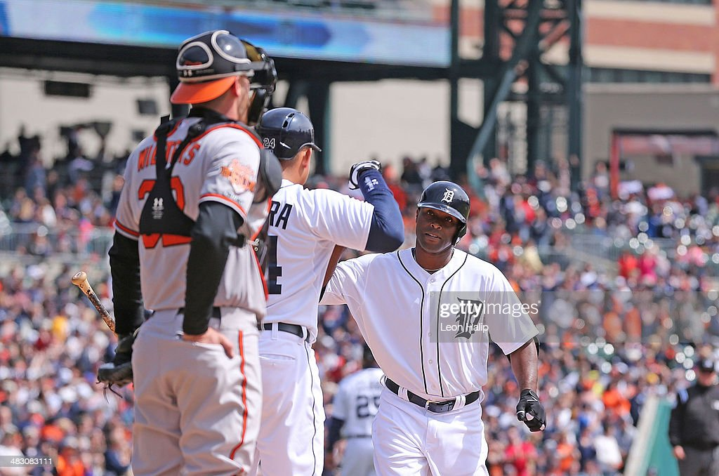 Torii Hunter #48 of the Detroit Tigers celebrates with teammate Miguel Cabrera #24 after hitting a solo home run to left field during the fourth inning of the game against the Baltimore Orioles at Comerica Park on April 6, 2014 in Detroit, Michigan.