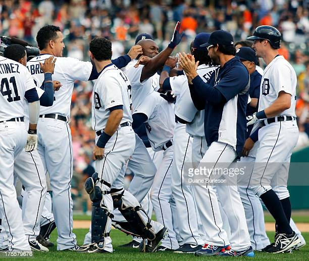 Torii Hunter of the Detroit Tigers is surrounded by teammates after hitting the gamewinning single in the 12th inning to defeat the Chicago White Sox...
