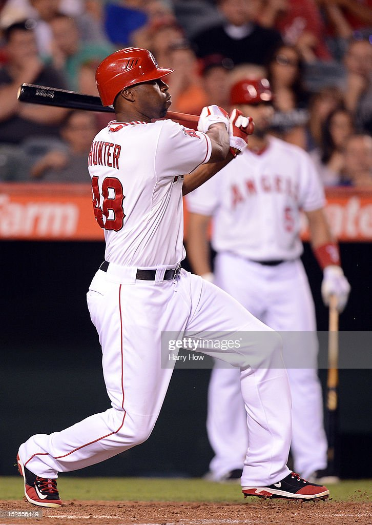 Torii Hunter #48 of the Los Angeles Angels hits a single to score two runs for a 5-1 lead over the Chicago White Sox during the fourth inning at Angel Stadium of Anaheim on September 21, 2012 in Anaheim, California.