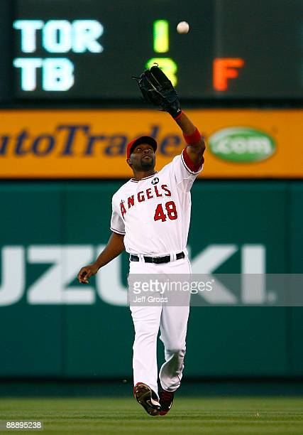 Torii Hunter of the Los Angeles Angels of Anaheim catches a pop fly in the second inning against the Texas Rangers at Angel Stadium on July 7, 2009...
