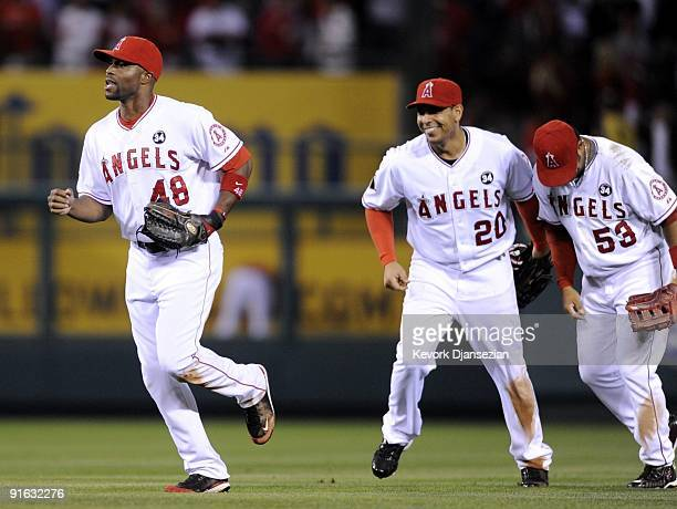 Torii Hunter of the Los Angeles Angels of Anaheim celebrates with teammates Juan Rivera and Bobby Abreu after their 50 victory over the Boston Red...