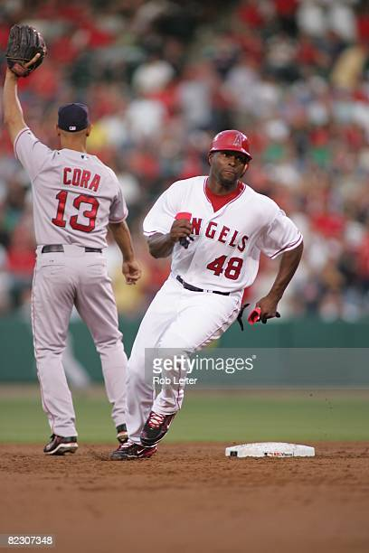 July 18: Torii Hunter of the Los Angeles Angels of Anaheim rounds second base during the game against the Boston Red Sox at Angel Stadium in Anaheim,...