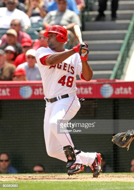 Torii Hunter of the Los Angeles Angels of Anaheim singles against the Cleveland Indians in the second inn ing on April 9, 2008 at Angel Stadium in...