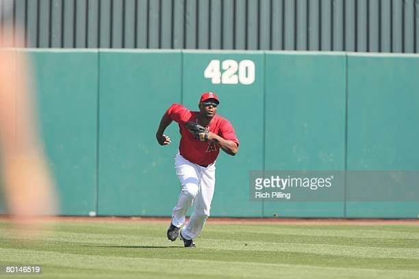 Torii Hunter of the Los Angeles Angles of Anaheim fields against the Chicago Cubs at Tempe Diablo Stadium in Tempe Arizona on March 1 2008 The Angels...