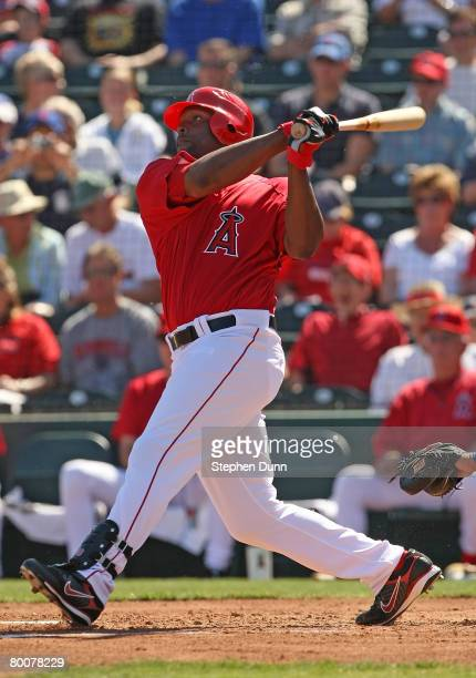 Torii Hunter of the Los Angels of Anaheim hits an RBI double in the second inning against the Chicago Cubs on March 1 2008 at Tempe Diablo Stadium in...