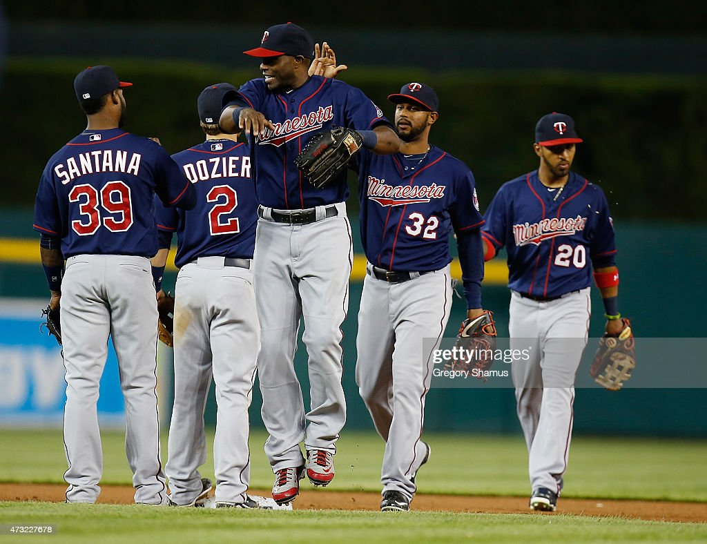Torii Hunter #48 of the Minnesota Twins celebrates a 6-2 win over the Detroit Tigers with teammates at Comerica Park on May 13, 2015 in Detroit, Michigan.