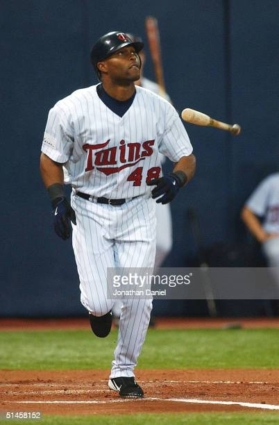 Torii Hunter of the Minnesota Twins drives in the first Twin run with a sacrifice fly scoring Shannon Stewart against the New York Yankees during...