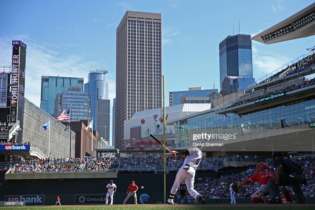 Torii Hunter #48 of the Minnesota Twins hits a single against the Los Angeles Angels of Anaheim in the fifth inning at Target Field on September 20, 2015 in Minneapolis, Minnesota. The Twins defeated the Angels 8-1.