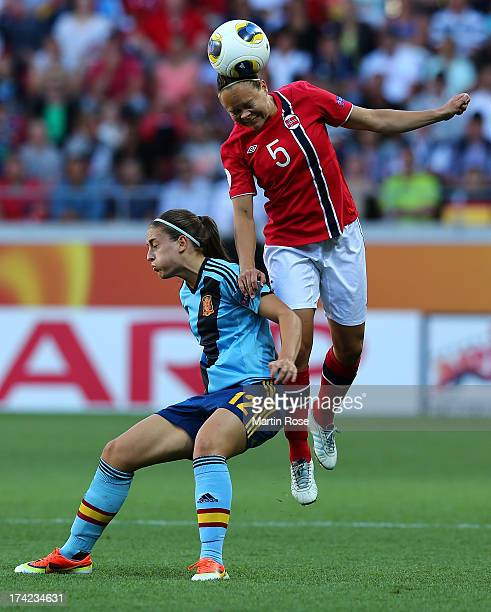 Toril Akerhaugen of Norway and Alexia Putellas of Spain battle for the ball during the UEFA Women's Euro 2013 quarter final match between Norway and...
