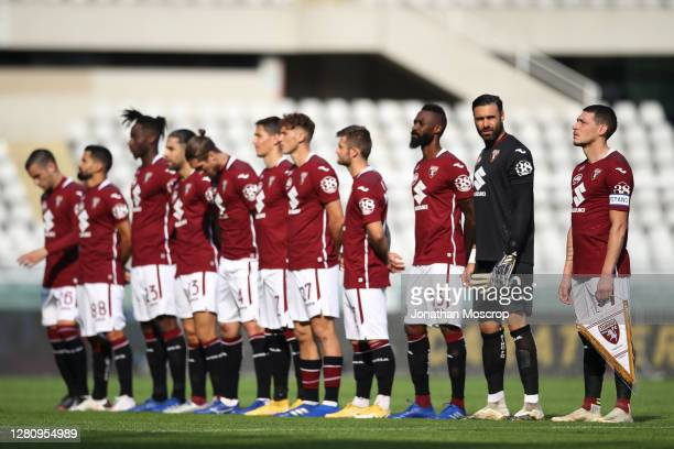 Torino FC captain Andrea Belotti holds a stendard in the line up with his team mates prior to the Serie A match between Torino FC and Cagliari Calcio...