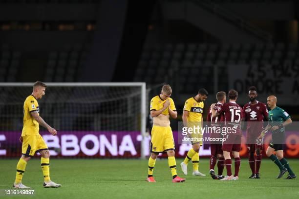 Torino FC players Cristian Ansaldi, Nicolas Nkoulou and Karol Linetty congratulate each other as Parma Calcio players Juraj Kucka, Andreas Cornelius...