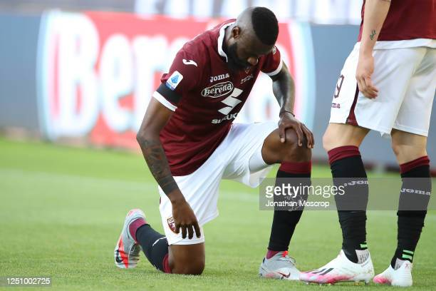 Torino FC's Cameroonian defender Nicolas Nkoulou takes the knee after scoring to give his side a 1-0 lead during the Serie A match between Torino FC...