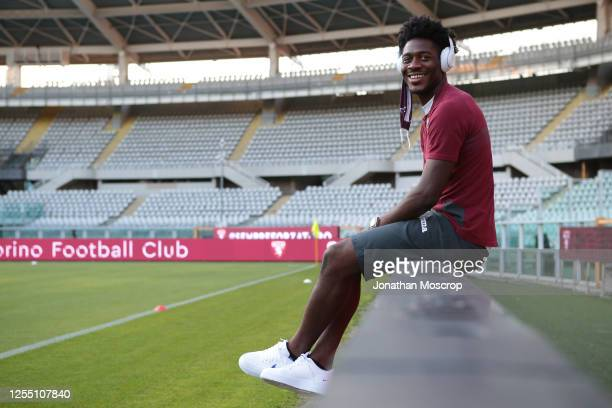 Torino FC's Nigerian defender Temitayo Ola Aina smiles as he listens to music whistle wearing headphones prior to during the Serie A match between...