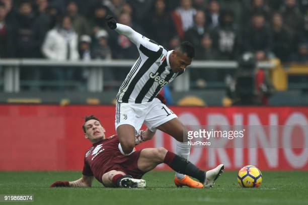 Torino forward Andrea Belotti tackles Juventus defender Alex Sandro during the Serie A football match n25 TORINO JUVENTUS on at the Stadio Olimpico...