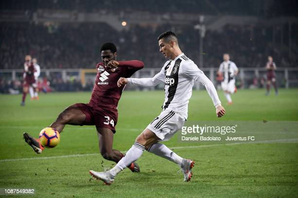 Torino player Ola Aina and Juventus player Cristiano Ronaldo during the Serie A match between Torino FC and Juventus at Stadio Olimpico di Torino on...