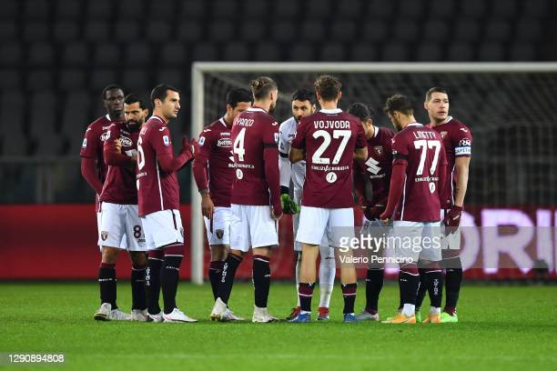 Torino players form a huddle during the Serie A match between Torino FC and Udinese Calcio at Stadio Olimpico di Torino on December 12, 2020 in...