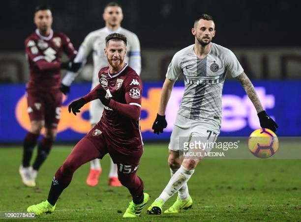 Torino's Argentine defender Cristian Ansaldi and Inter Milan's Croatian midfielder Marcelo Brozovic go for the ball during the Italian Serie A...