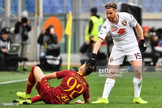 Torino's Argentine defender Cristian Ansaldi comforts AS Roma Italian forward Stephan El Shaarawy after he tackled him during the Italian Serie A...