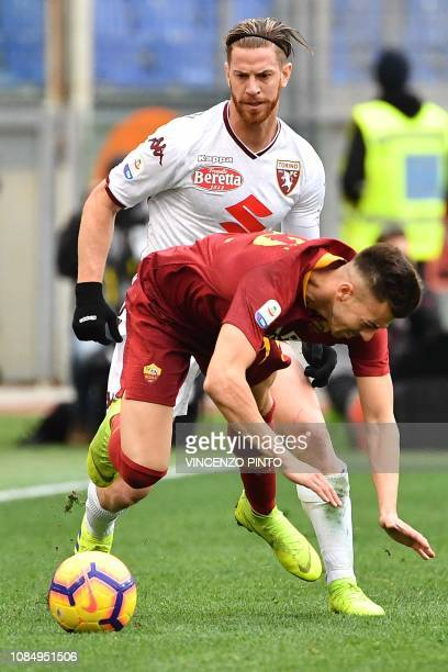 Torino's Argentine defender Cristian Ansaldi tackles AS Roma Italian forward Stephan El Shaarawy during the Italian Serie A football match AS Roma vs...