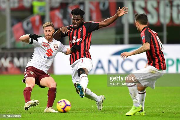Torino's Argentine defender Cristian Ansaldi vies with AC Milan's Ivorian midfielder Franck Kessie during the Italian Serie A football match between...