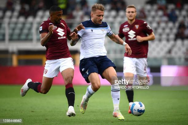 Torinos Brazilian defender Bremer fights for the ball with Lazios Italian forward Ciro Immobile during the Italian Serie A football match between...