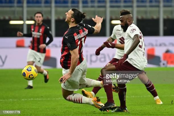 Torino's Cameroon defender Nicolas Nkoulou tackles AC Milan's Swedish forward Zlatan Ibrahimovic during the Italian Cup round of sixteen football...