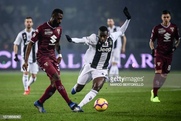 Torino's Cameroonian defender Nicolas Nkoulou and Juventus' French midfielder Blaise Matuidi go for the ball during the Italian Serie A football...