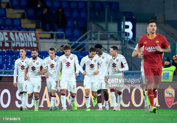 Torino's forward Andrea Belotti celebrates with team mates after he scored a goal during the Italian Serie A football match between Roma and Torino...
