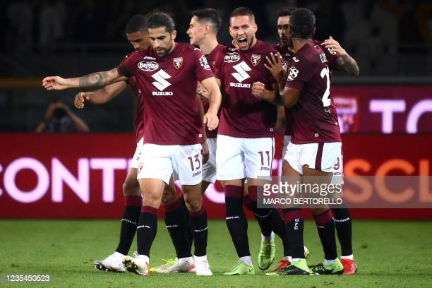 Torino's forward Marco Pjaca from Croatia celebrates with teammates after scoring a goal during the Italian Serie A football match Torino vs Lazio on...