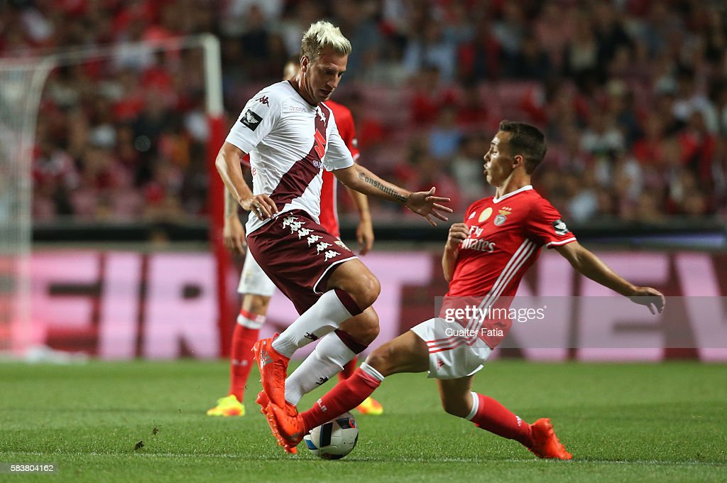 Torino's forward Maxi Lopez with SL Benfica's defender from Spain Alex Grimaldo in action during the Eusebio Cup match between SL Benfica and Torino at Estadio da Luz on July 27, 2016 in Lisbon, Portugal.