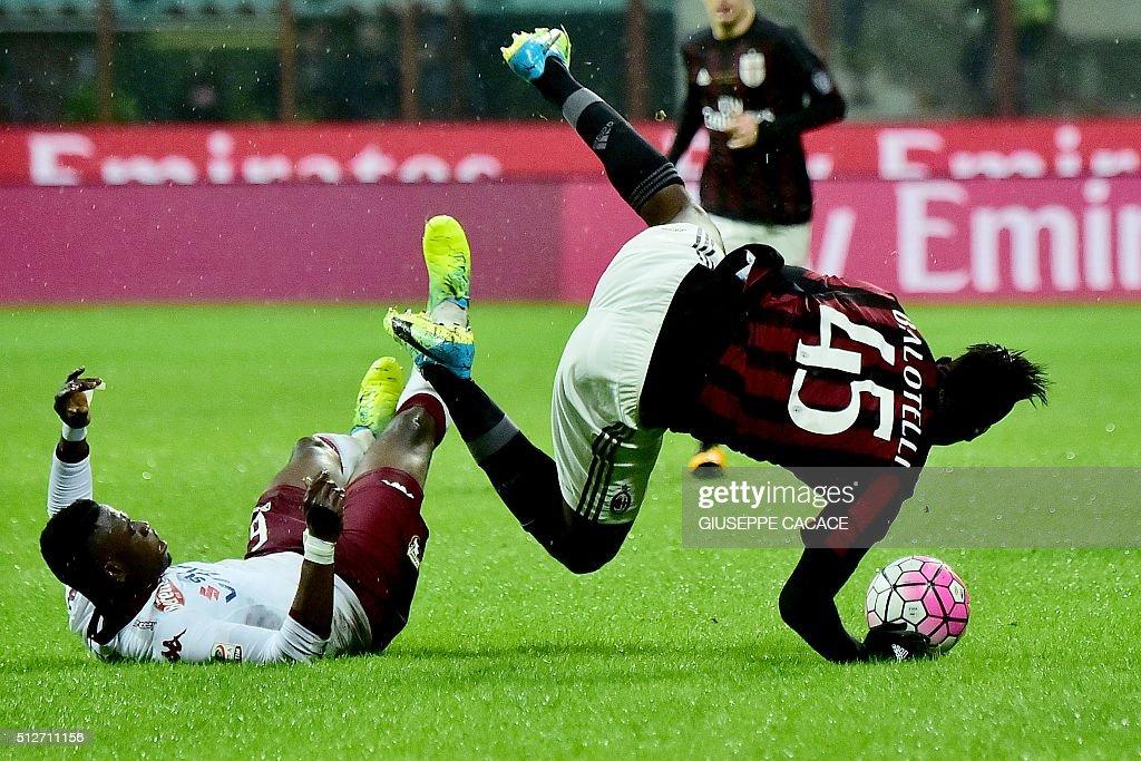 Torino's Ghanaian midfielder Afriyie Acquah (L) fouls AC Milan's Italian forward Mario Balotelli during the Italian Serie A football match between AC Milan and Torino at the San Siro Stadium in Milan on February 27, 2016. / AFP / GIUSEPPE