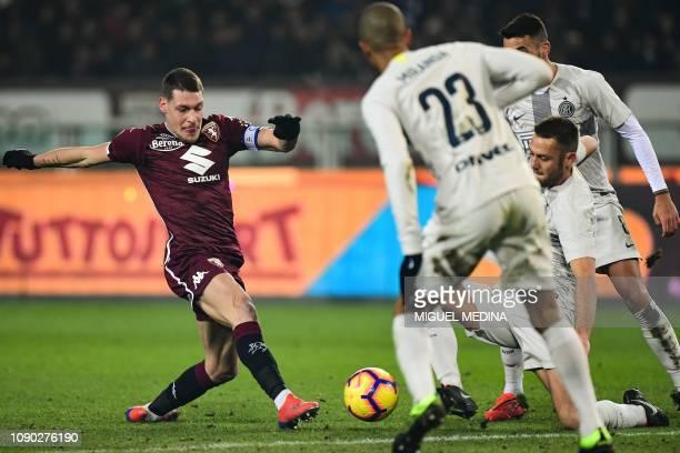 Torino's Italian forward Andrea Belotti and Inter Milan's Dutch defender Stefan de Vrij go for the ball during the Italian Serie A football match...