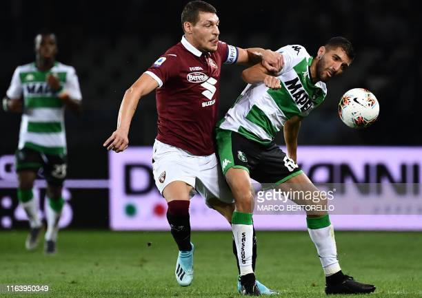 Torino's Italian forward Andrea Belotti and Sassuolo's Moroccan midfielder Mehdi Bourabia go for the ball during the Italian Serie A football match...