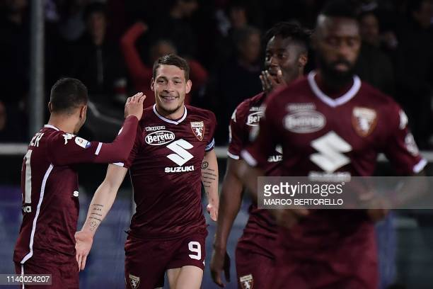 Torino's Italian forward Andrea Belotti celebrates with his teammates after scoring a goal during the Italian Serie A football match between Torino...