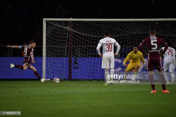Torino's Italian forward Andrea Belotti scores a penalty during the Italian Serie A football match between Torino and AC Milan on April 28, 2019 at...
