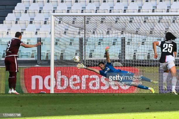 Torino's Italian forward Andrea Belotti scores a penalty past Juventus' Italian goalkeeper Gianluigi Buffon during the Italian Serie A football match...