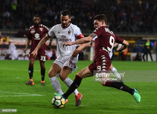 Torino's Italian forward Andrea Belotti vies with AC Milan's Captain Italian defender Leonardo Bonucci during the Italian Serie A football match...