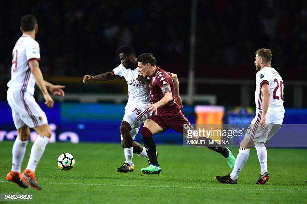 Torino's Italian forward Andrea Belotti vies with AC Milan's Ivorian midfielder Franck Kessie and AC Milan's Italian defender Ignazio Abate during...