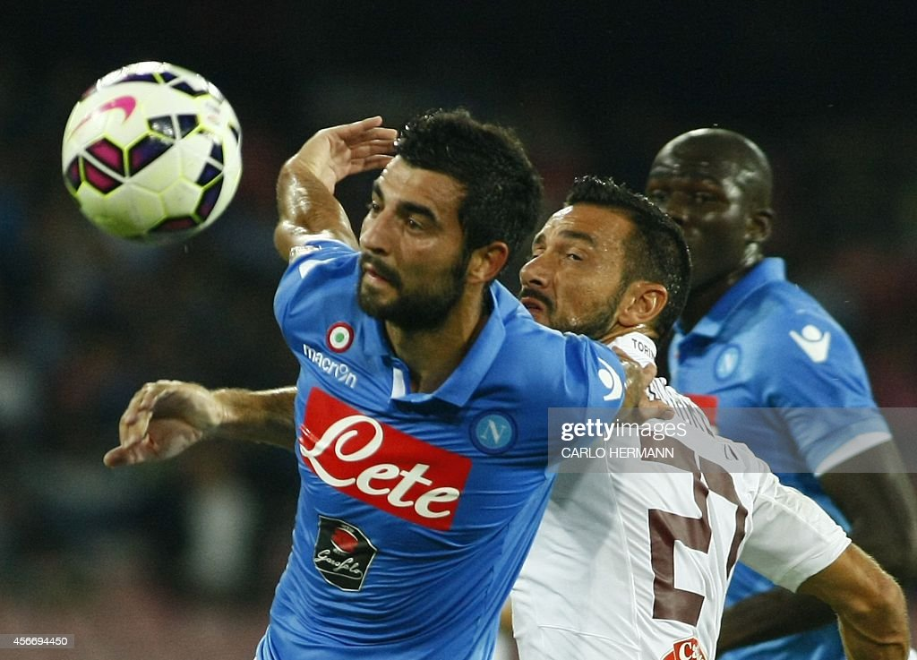 Torino's Italian forward Fabio Quagliarella (C) vies with with Napoli's Spanish defender Raul Albiol (L) and Napoli's French defender Kalidou Koulibaly during the Italian Serie A football match SSC Napoli vs Torino FC on October 5, 2014 at the San Paolo stadium in Naples