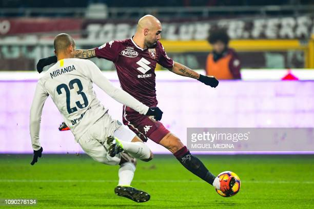Torino's Italian forward Simone Zaza attempts to shoot on goal despite Inter Milan's Brazilian defender Miranda during the Italian Serie A football...