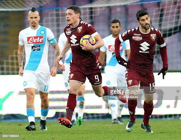 Torino's Italian midfielder Marco Benassi celebrates after scoring a goal with his teammate Italian forward Andrea Belotti during the Italian Serie A...