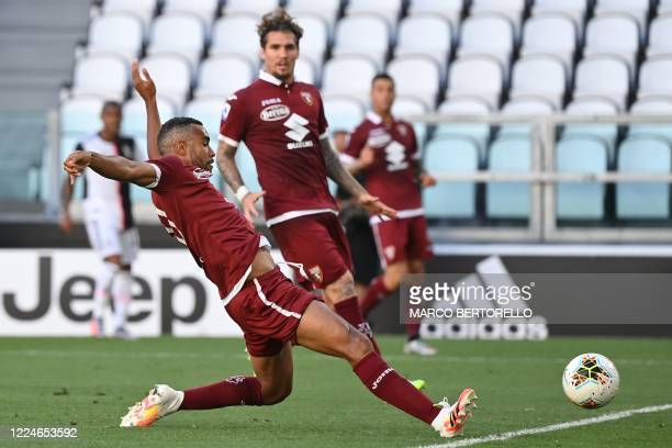 Torino's Ivorian defender Koffi Djidji scores an own goal during the Italian Serie A football match Juventus vs Torino played behind closed doors on...