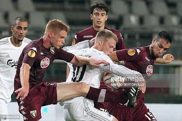 Torino's midfielder Alessandro Gazzi fights for the ball with Kobenhavn's midfielder Nicolai Jorgensen during the Europa League Group B football...