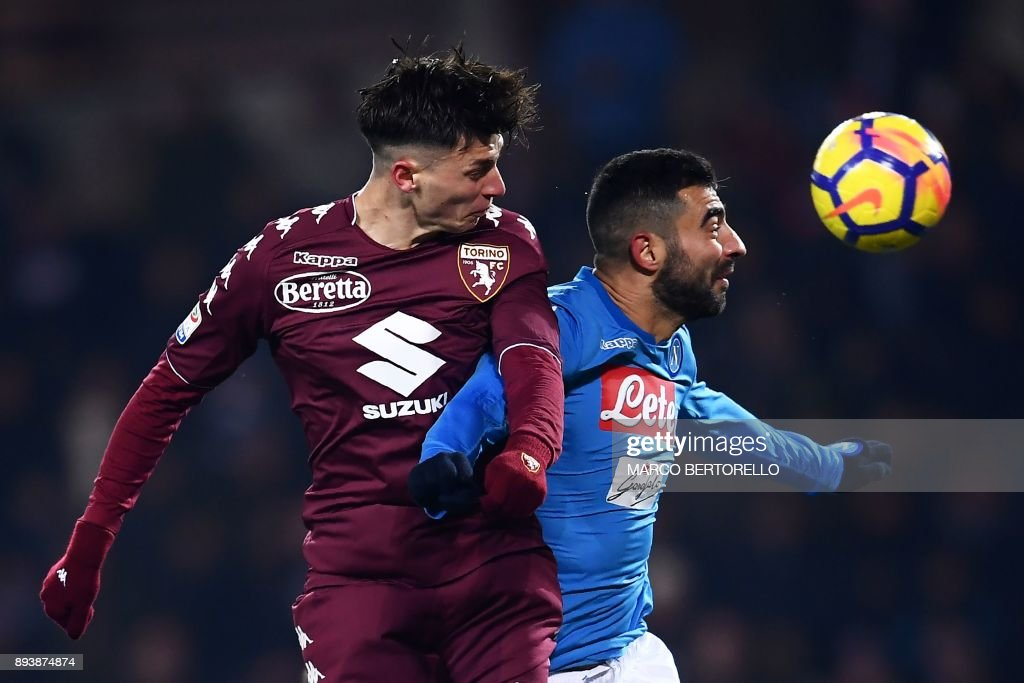 Torino's midfielder Daniele Baselli (L) and Napoli's defender Raul Albiol of Spain jump for the ball during the Italian Serie A football match Torino Vs Napoli on December 16, 2017 at the 'Grande Torino' stadium in Turin. /