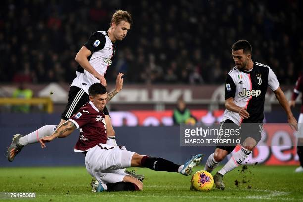 Torino's midfielder Daniele Baselli from Italy fights for the ball with Juventus' midfielder Miralem Pjanic of Bosnia-Erzegovina during the Italian...