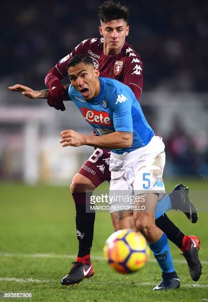 Torino's midfielder Daniele Baselli from Italy fights for the ball with Napoli's midfielder Allan from Brazil during the Italian Serie A football...