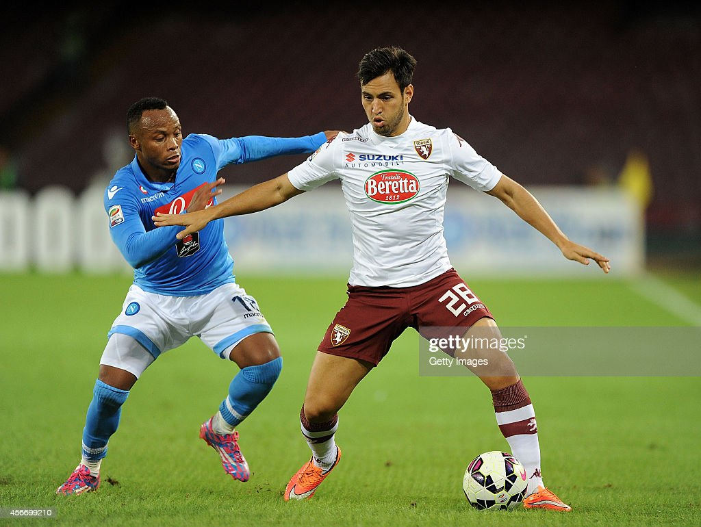 Torino's player Juan sanchez Mino vies with Napoli's player Camillo Zuniga during an Italian Serie A football match SSC Napoli vs Torino at the San Paolo Stadium in Naples on October 5, 2014.