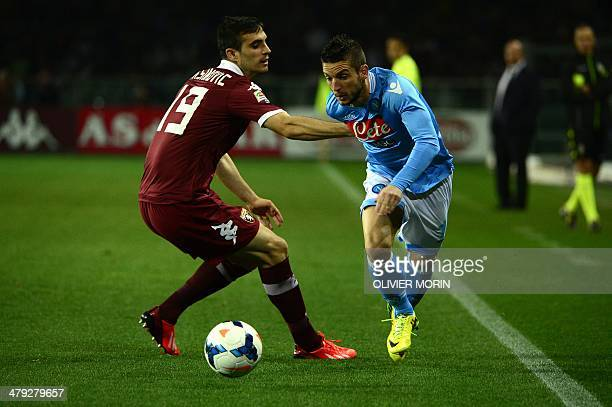Torino's Serbian defender Nikola Maksimovic fights for the ball Napoli's Belgian forward Dries Mertens during the Italian Serie A football...